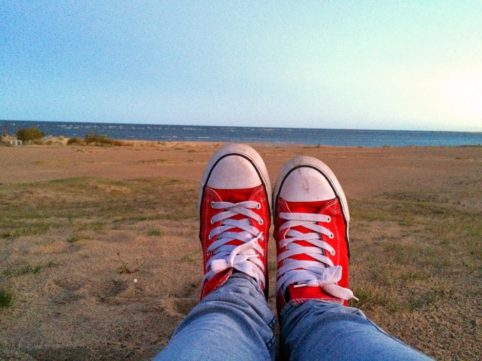 sunrise beach red sneakers sea